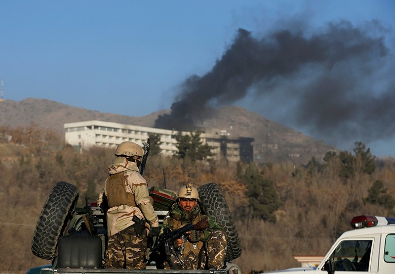 Afghan security forces keep watch as smoke rises from the Intercontinental Hotel in Kabul, Afghanistan, Jan. 21, 2018. (Reuters Photo)
