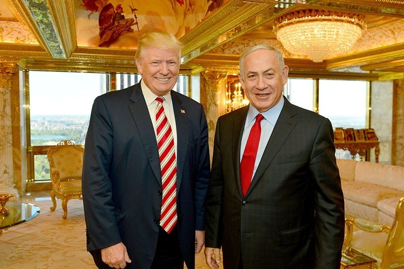 Israeli Prime Minister Benjamin Netanyahu (R) stands next to Republican U.S. presidential candidate Donald Trump during their meeting in New York, September 25, 2016. (Handout photo via Reuters)