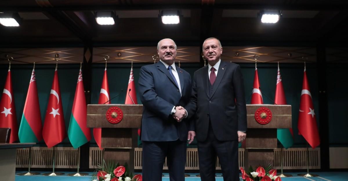 President Recep Tayyip Erdou011fan, right, and Belarusian President Alexander Lukashenko shakes hands before their talks in Ankara, April 16, 2019.