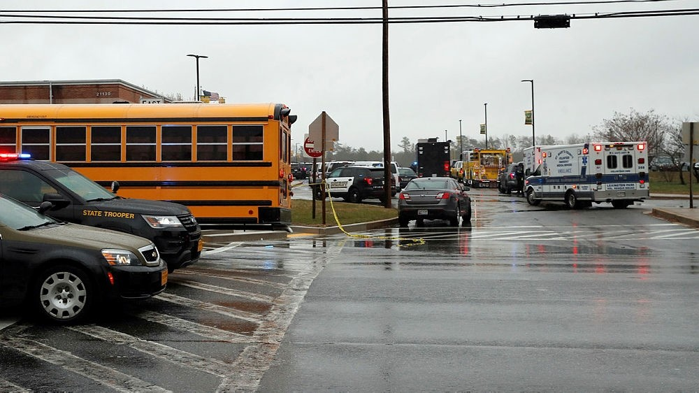 Vehicles of first responders and school buses are parked at the entrance to Great Mills High School Tuesday, March 20, 2018, in Great Mills. (AP Photo)