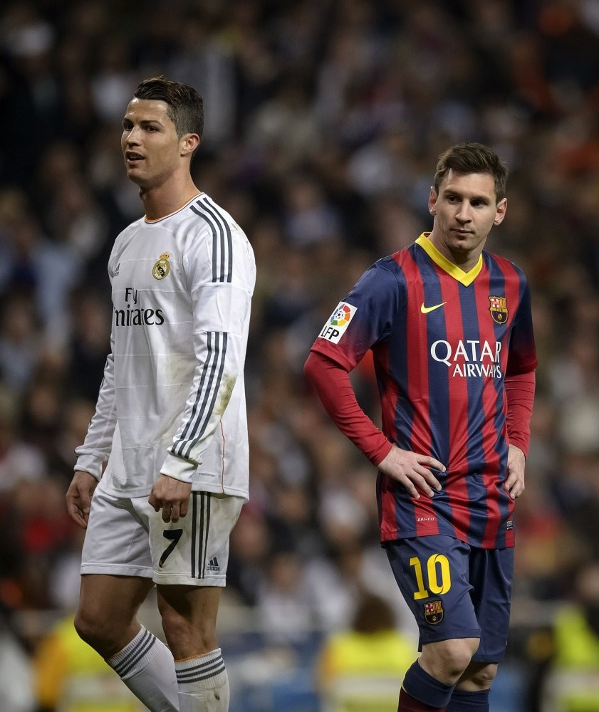Barcelonau2019s Argentinian forward Lionel Messi (R) standing near Real Madridu2019s Portuguese forward Cristiano Ronaldo during a  u201cEl clasicou201d Spanish League football match.