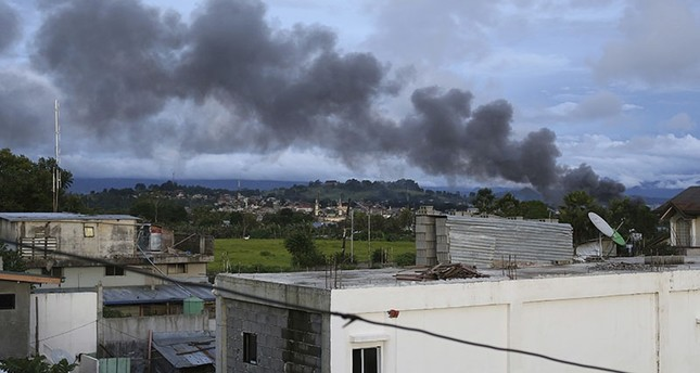 Black smoke from air strikes fills the sky as fighting continues in Marawi city, southern Philippines Friday, June 9, 2017. AP Photo