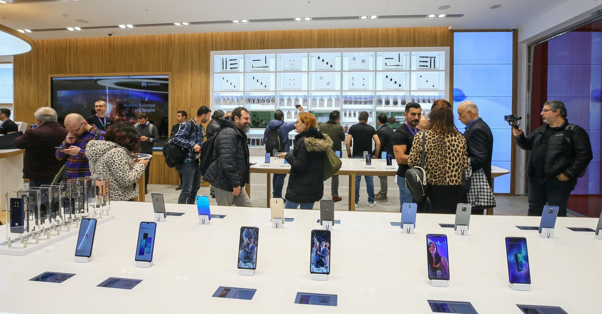 In this file photo, people are seen in a Huawei store in the western province of u0130zmir, Feb. 2, 2019. (AA Photo)