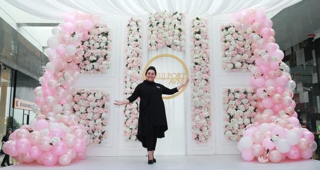 Zehra Özkaymaz, who is known as Zeruj on social media, poses during the opening on May 11.