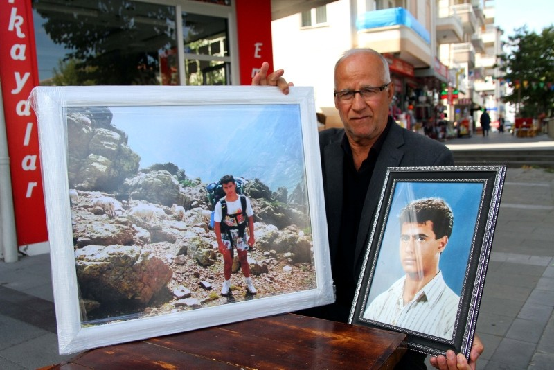 Yusuf Taru0131m holds picture of his deceased son Hasan Taru0131m, who went missing on French Alps 26 years ago. (AA Photo)