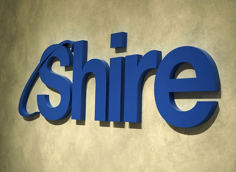 This April, 2018 photo, shows a logo of Shire in Tokyo. (AP Photo)