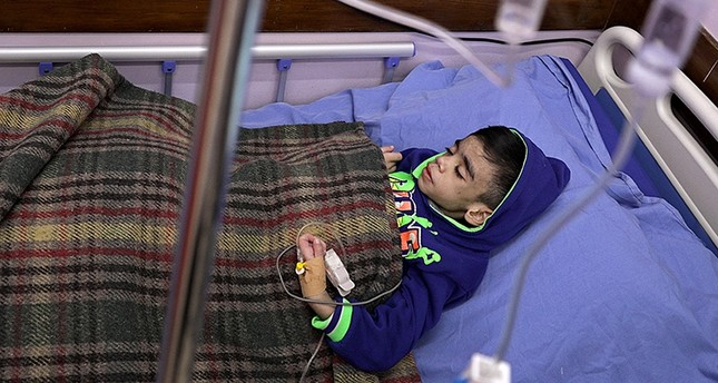 Fadi Moahammed Atiya, a seven-years old brain cancer patient, receives medical care inside al-Rantisi cancer hospital in Gaza City, 04 February 2018. (EPA Photo)