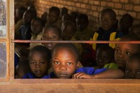 As a young senior student at Tabudirira Primary School hits a huge piece of metal dangling from a tree that serves as a bell, ringing fills the air of the school yard, sending about 300 children,...