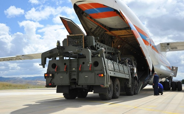Military vehicles and equipment, parts of the S-400 air defense systems, are unloaded from a Russian transport aircraft, at Murted military airport in Ankara, Turkey, Friday, July 12, 2019. Turkish Defense Ministry via AP, Pool