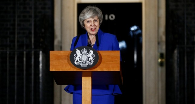 Britain's Prime Minister Theresa May makes a statement following winning a confidence vote, after Parliament rejected her Brexit deal, outside 10 Downing Street in London, Britain, Jan. 16, 2019. Reuters Photo