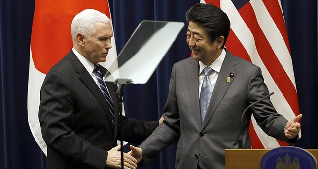 U.S. Vice President Mike Pence, left, and Japan's Prime Minister Shinzo Abe shake hands during their joint announcement after their meeting at Abe's official residence in Tokyo Wednesday, Feb. 7, 2018. (AP Photo)