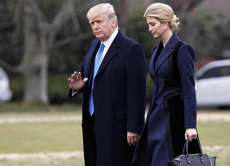 In this Feb. 1, 2017, photo, Trump, accompanied by his daughter Ivanka, waves as they walk to board Marine One in Washington. (AP Photo)