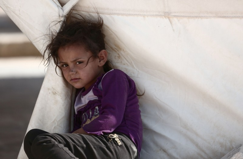 A child is pictured at a camp for the displaced from the opposition-held Syrian province of Idlib, at the village of al-Ghadfa, southeast of the province on September 2, 2018. (AFP Photo)