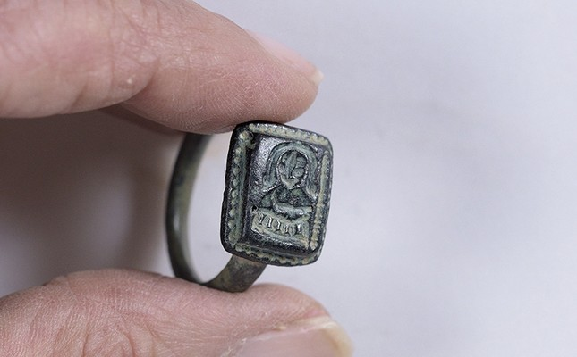 A picture made available on 26 February 2108, released by Israel Antiquities Authority show Israeli employees of the Israel Antiquities Authority holding a bronze rare ring from Middle Ages of St. Nicholas (EPA Photo)