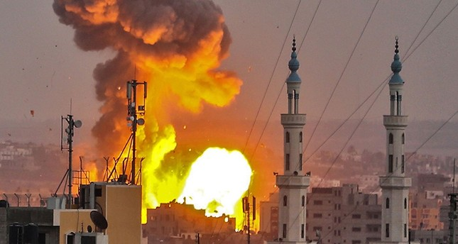 A picture taken on July 20, 2018 shows a fireball exploding in Gaza City during Israeli bombardment. Israeli aircraft and tanks hit targets across the Gaza Strip. AFP Photo