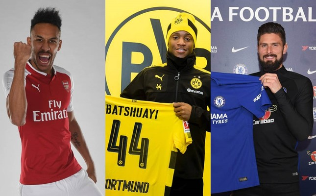 Pierre-Emerick Aubameyang, left, Michy Batshuayi, center, and Olivier Giroud pose with t-shirts of their new clubs.