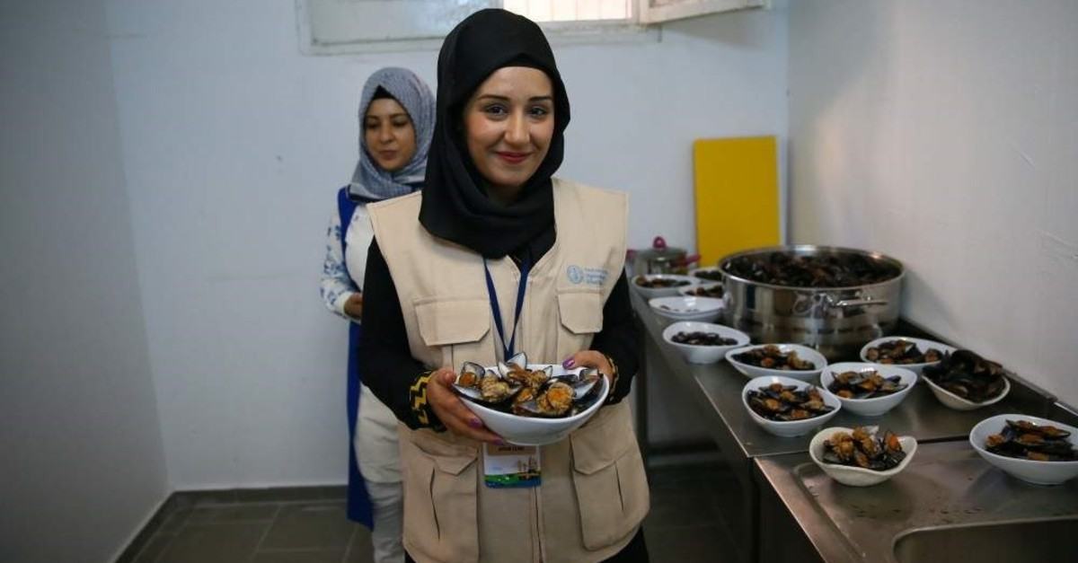 Ten Syrian and 10 Turkish women founded the cooperative that runs the stuffed mussel facility. (AA Photo)
