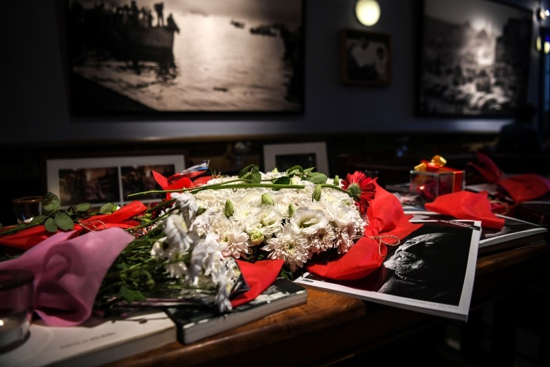 Flowers and portraits of late Turkish photographer Ara Güler have been put where he used to stay, at Ara Cafe in Istanbul, on October 19, 2018.