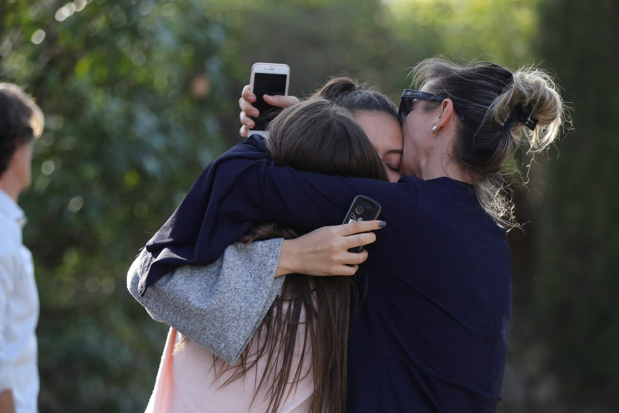 People react near the Tocqueville high school in the southern French town of Grasse, on March 16, 2017 following a shooting. (AFP Photo)