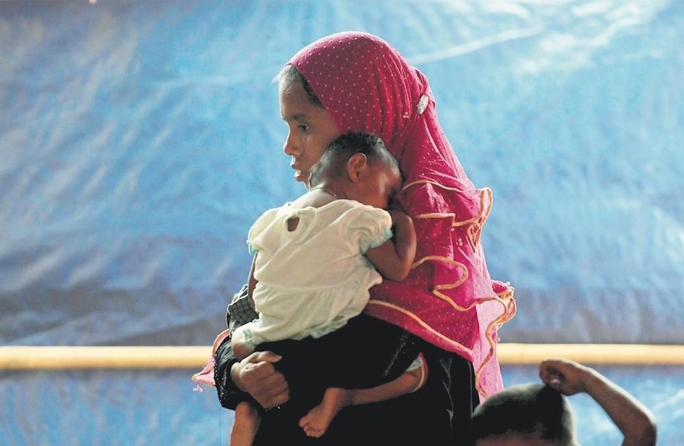 Rohingya refugees visit a health clinic at the Balukhali refugee camp near Cox's Bazar, Bangladesh, Dec. 11.