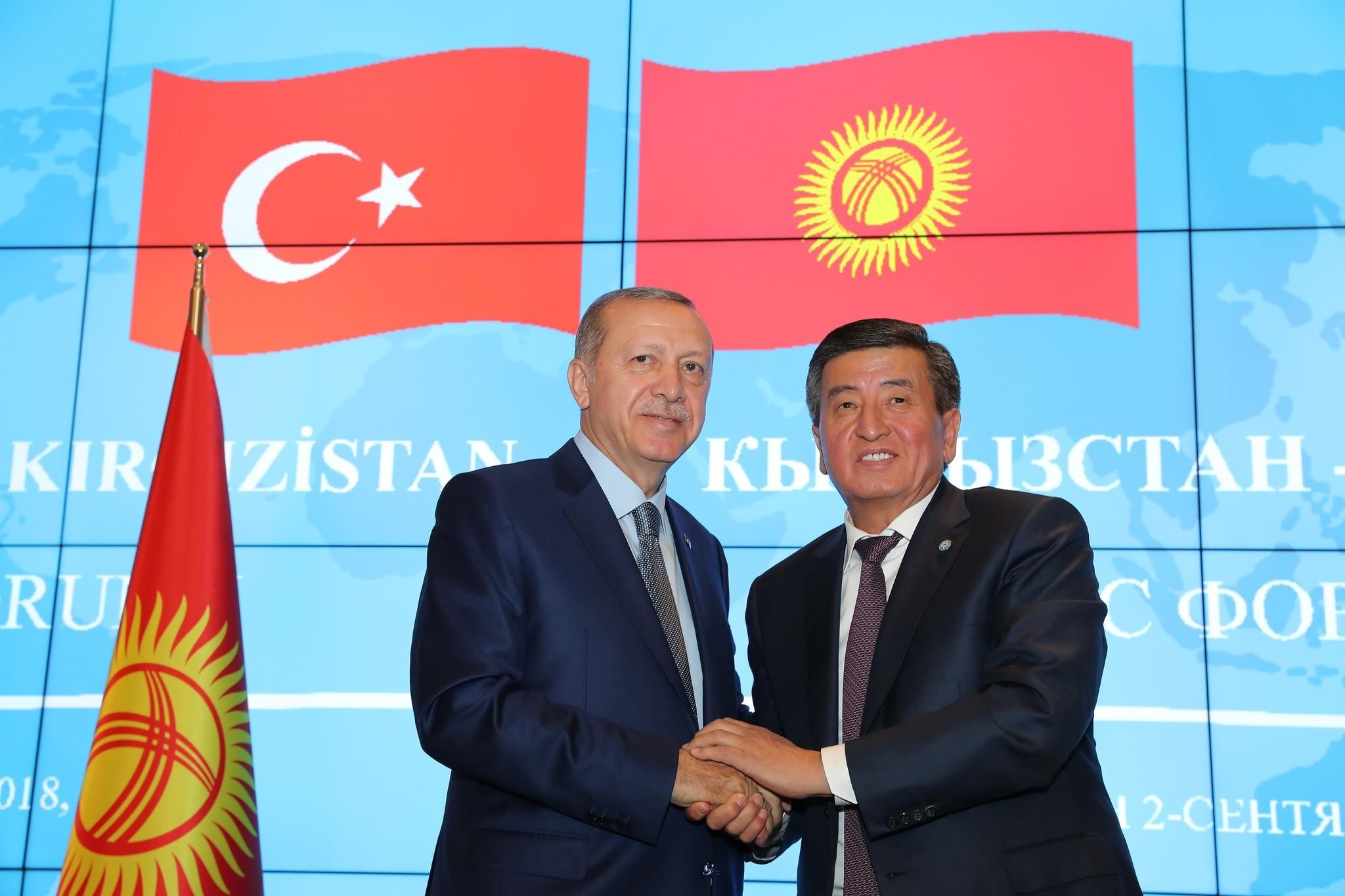 President Recep Tayyip Erdou011fan and Kyrgyzstanu2019s President Sooronbay Jeenbekov shake hands on the sidelines of the Turkey-Kyrgyzstan Business Forum in the Kyrgyz capital Bishkek, Sept. 2.
