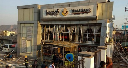 pTwo women were killed and 11 others injured when two bombs exploded at a branch of local Yoma Bank in northeastern Shan state Wednesday, according to police./p