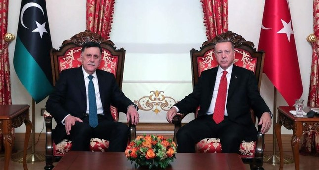 President Recep Tayyip Erdo?an (R) and Fayez al-Sarraj (L), the head of the Tripoli-based Government of National Accord (GNA), pose during their meeting in Istanbul, Nov. 27, 2019. (AFP)