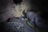 Homeless migrants hide in 2,000-year-old Greek stone walls