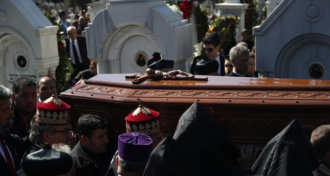 People carry the coffin of Patriarch Mesrob II at his a funeral in Istanbul, March 17, 2019.
