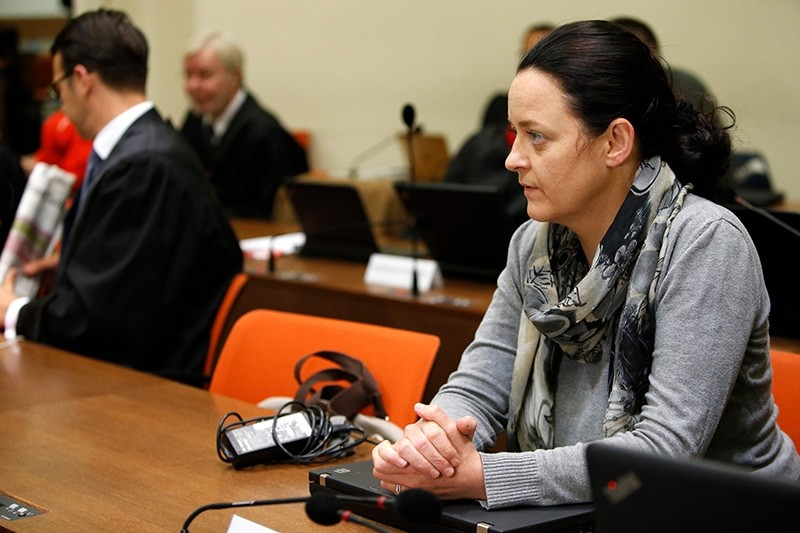 Defendant Beate Zschaepe (L) awaits for the continuation of her trial at a courtroom in Munich, southern Germany on May 2, 2018. (AFP Photo)