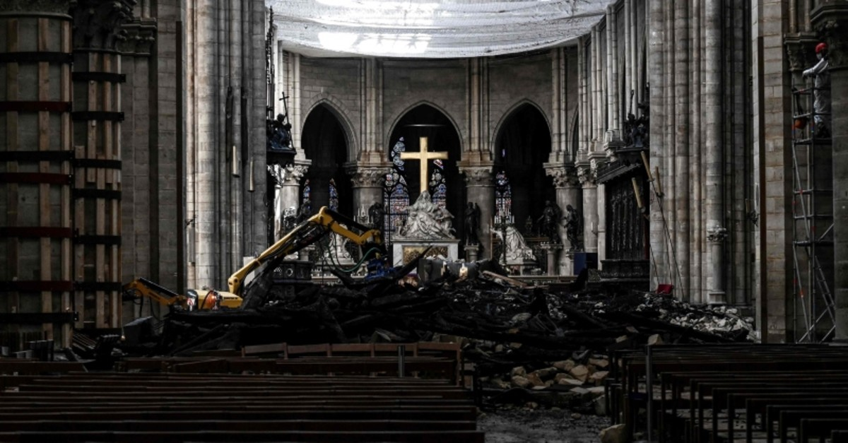 In this photo taken on May 15, 2019 in Paris, shows rubble and the cross at the altar inside the Notre Dame de Paris Cathedral after it sustained major fire damage. (AFP Photo)