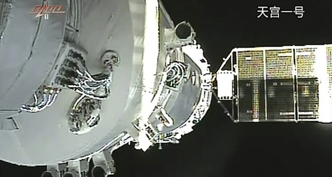 In this Nov. 3, 2011, file image taken from video from China's CCTV via AP Video, China's Shenzhou-8 spacecraft is docked with the orbiting Tiangong-1 space station. (AP Photo)