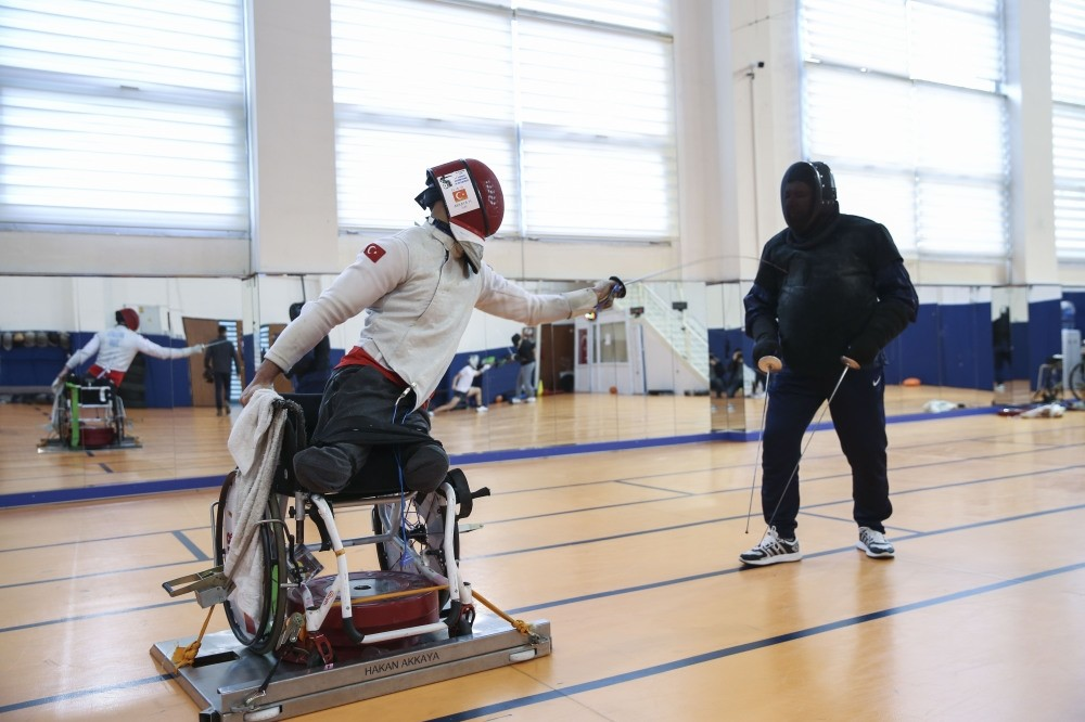 Hakan Akkaya (L) in a training session. the 26-year-old athlete is eyeing title in the 2020 Tokyo Paralympics.