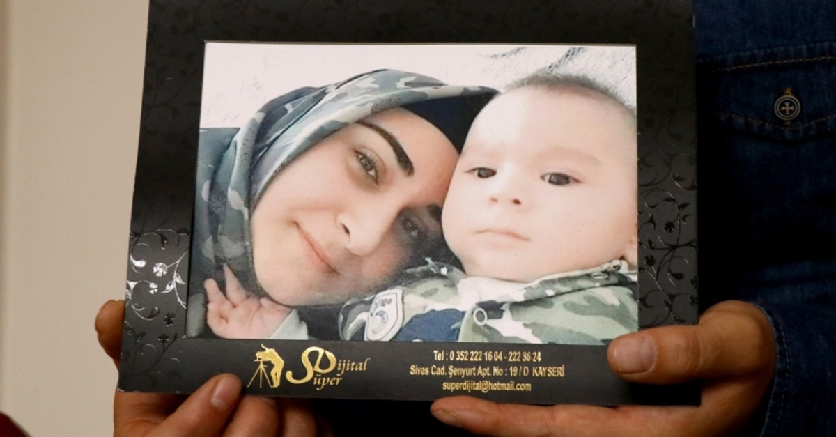 Sercan Karakaya, non-commissioned officer who lost his 25-year-old wife Nurcan and 11-month-old son Mustafa in a PKK roadside bomb attack on July 31, 2018, hold their picture during an interview on May 11, 2019, in Kayseri, central Turkey. (AA Photo)