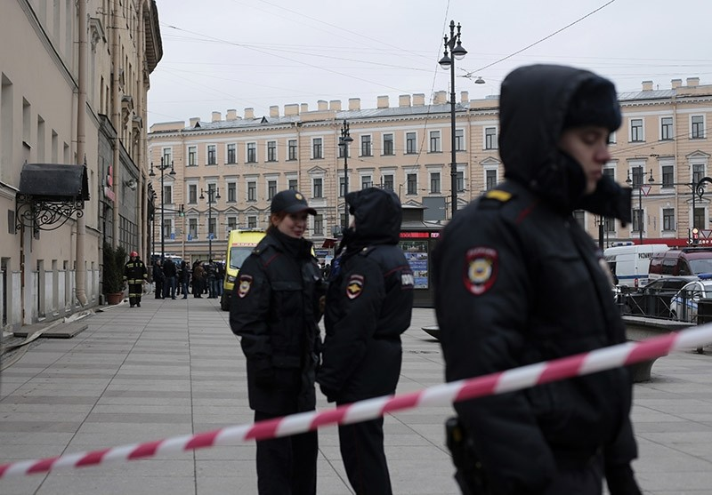 Russian police officers stand guard in a street after a explosion in St. Petersburg's subway, Russia, Monday, April 3, 2017 (AP File Photo)