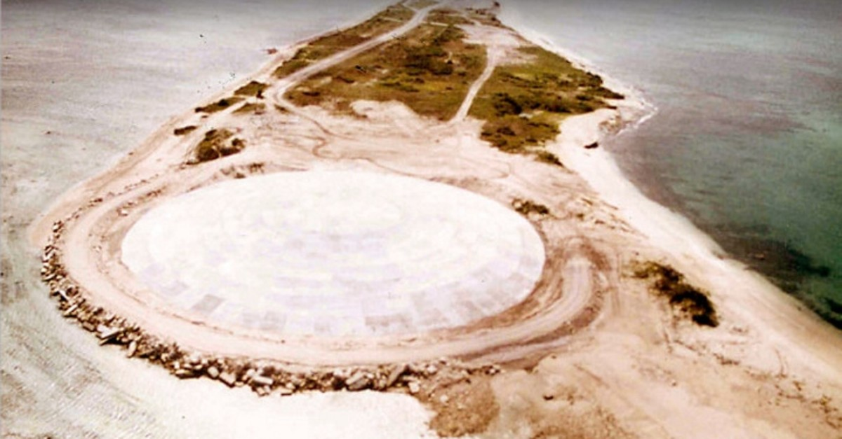 Picture taken by the US Defense Nuclear Agency in 1980, shows the huge dome built over top of a crater left by one of the 43 nuclear nuclear tests over Runit Island in Enewetak in the Marshall Islands (AFP Photo)