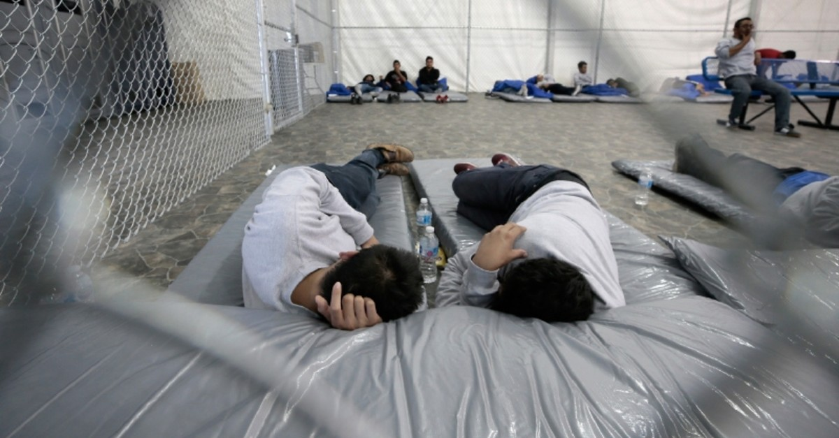 Migrants nap in the new soft-sided migrant holding facility in Tornillo, Texas Thursday, Aug. 15, 2019 (AP Photo)