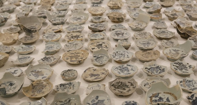 Wei has a vast collection of broken old porcelain, all bearing a tiger figure unique to the dynasty.