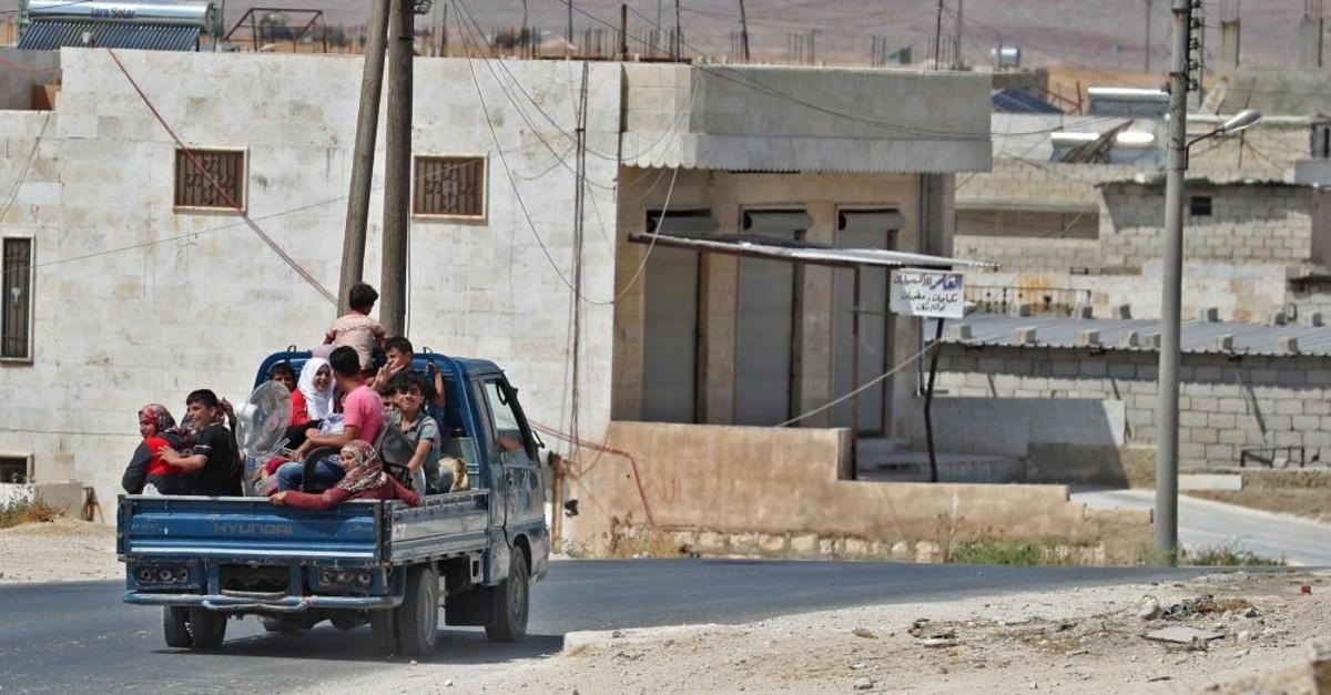 Syrian civilians flee Idlib, where regime bombardment has killed hundreds since late April, Aug. 22, 2019.