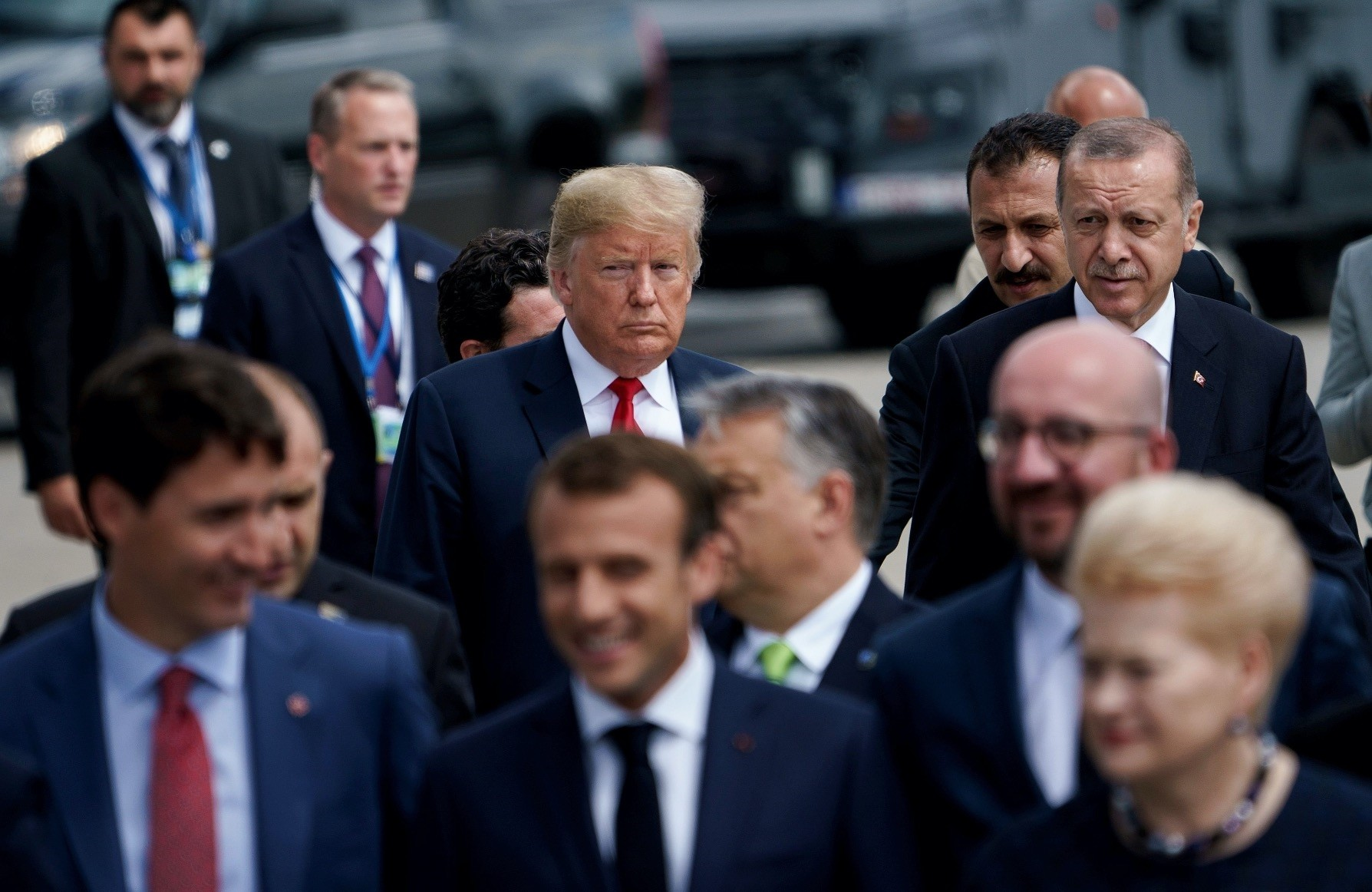 U.S. President Trump (L) and President Recep Tayyip Erdou011fan (R) walk behind the other NATO leaders during NATOu2019s Brussels meeting on July 11.