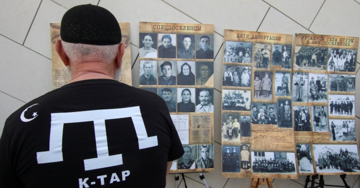 A man looks at an exhibition at a rally, commemorating Crimean Tatars mass deportations from the region in 1944, in the village of Siren, in Bakhchisaray district, Crimea, May 18, 2019. (Reuters Photo)