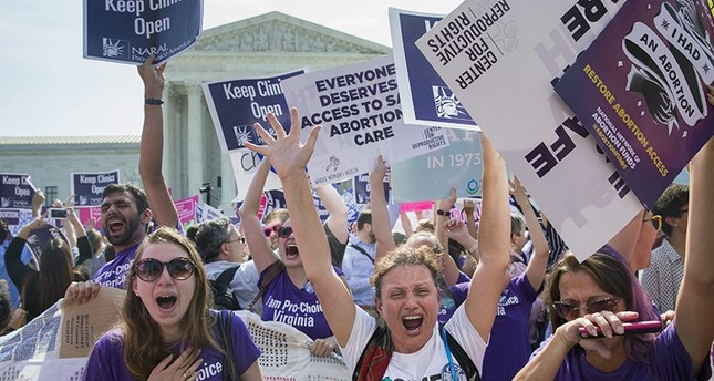 Pro-choice supporters celebrate outside the Supreme Court after the court's ruling  (EPA Photo)