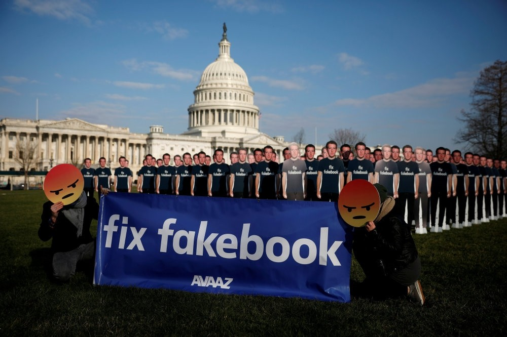 Dozens of cardboard cutouts of Facebook CEO Mark Zuckerberg at an Avaaz.org protest outside the U.S. Capitol in Washington.