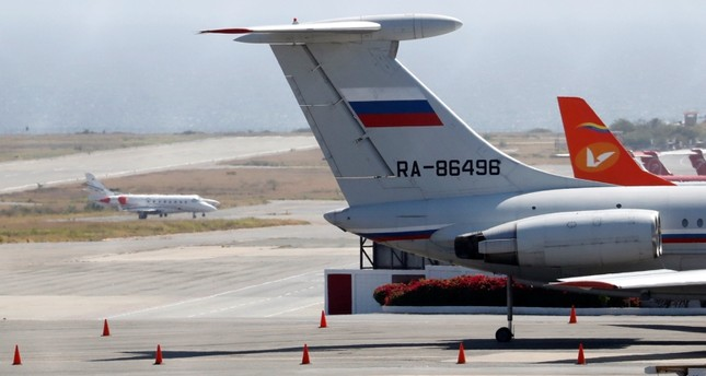 An airplane with the Russian flag is seen at Simon Bolivar International Airport in Caracas, Venezuela March 24, 2019. Reuters Photo
