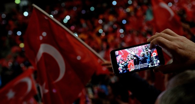 Participants taking photographs at a meeting about held by Prime Minister Binali Yılıdırım the upcoming April referendum in Oberhausen, Germany, Feb. 18.