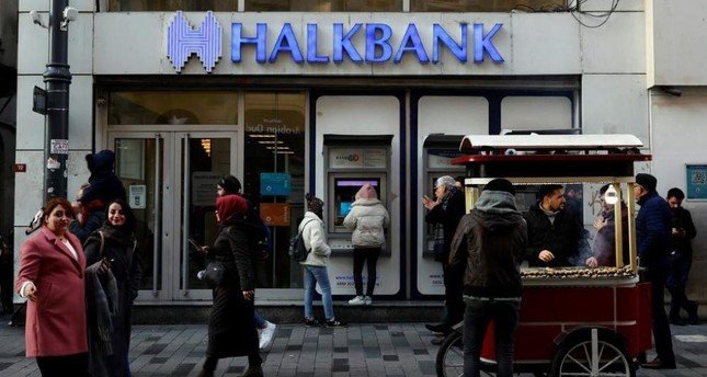 People walk past a branch of Halkbank in central Istanbul, Turkey, Jan. 22, 2020. Reuters Photo