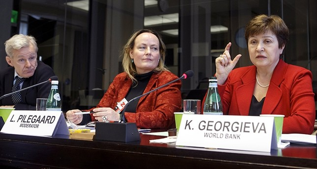 World Bank Chief Executive Officer Kristalina Georgieva (R) sitting next to Jan Egeland (L) and moderator Lisberth Pilegaard, speaks during a panel at the European headquarters of the United Nations in Geneva, Switzerland (EPA Photo)
