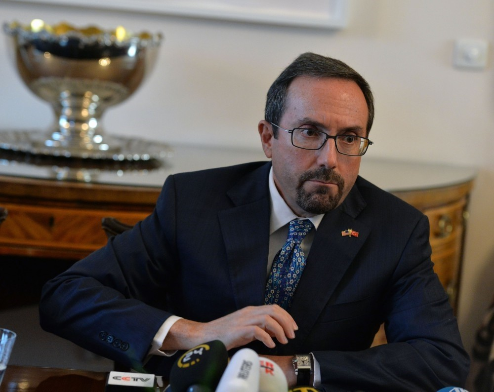 U.S. Ambassador John Bass attends a news conference in Ankara Wednesday after President Erdou011fan slammed him for his stance in a number of issues in bliateral ties.