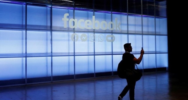 In this file photo, an attendee seen taking a photograph of a sign during Facebook Inc.'s F8 Developer Conference in San Jose, California, U.S., April 30, 2019. Reuters Photo