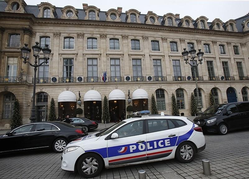 A police car drives past the Ritz hotel in Paris, Thursday, Jan. 11, 2018 (AP Photo)